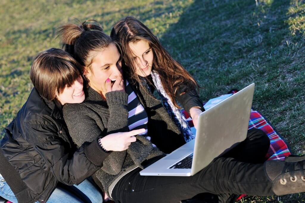 group of teen girl woman outdoor have fun and study